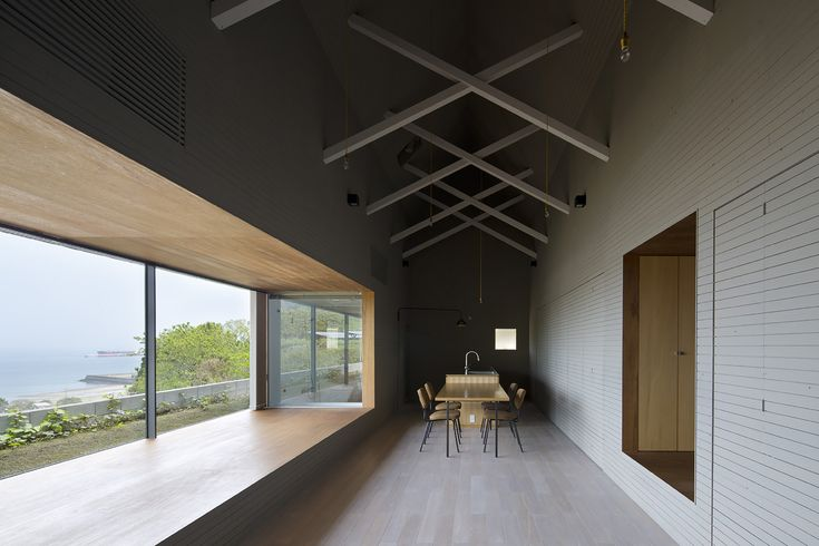 Completed in 2015 in Kagoshima, JapanThe house on a boundary line. This project is for a family of five in the middle of a small mountain where is able to overlook Mt. Sakurajima beyond...