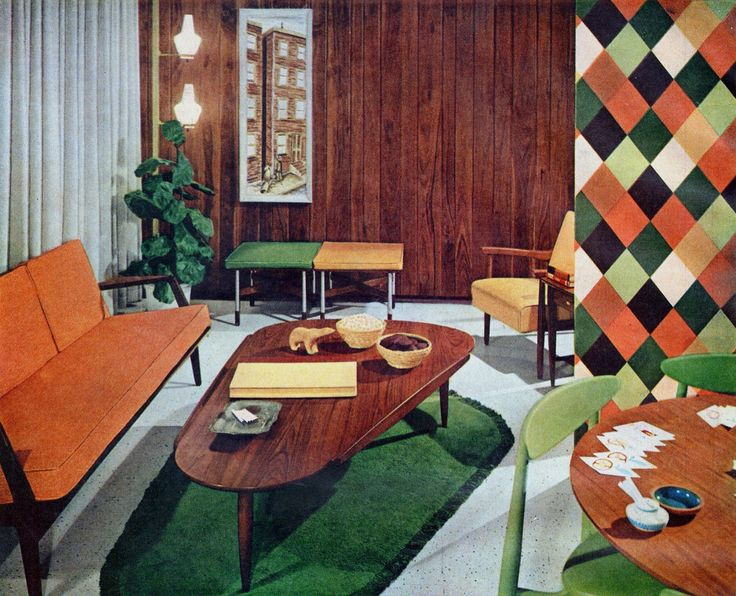 1950s: Wonderful rich colours with the designers friend, teak wood furniture and panelling, in this 1958 room design.