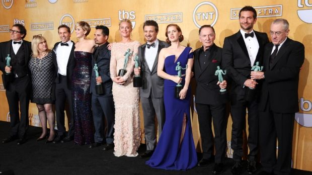 SAG AWARD WINNER 2014 for outstanding performance by a cast in a motion picture for AMERICAN HUSTLE. From left, David O. Russell, Colleen Camp, Alessandro Nivola, Jennifer Lawrence, Michael Pena, Elisabeth Rohm, Jeremy Renner, Amy Adams, Paul Herman, Bradley Cooper and Robert De Niro pose in the press room.