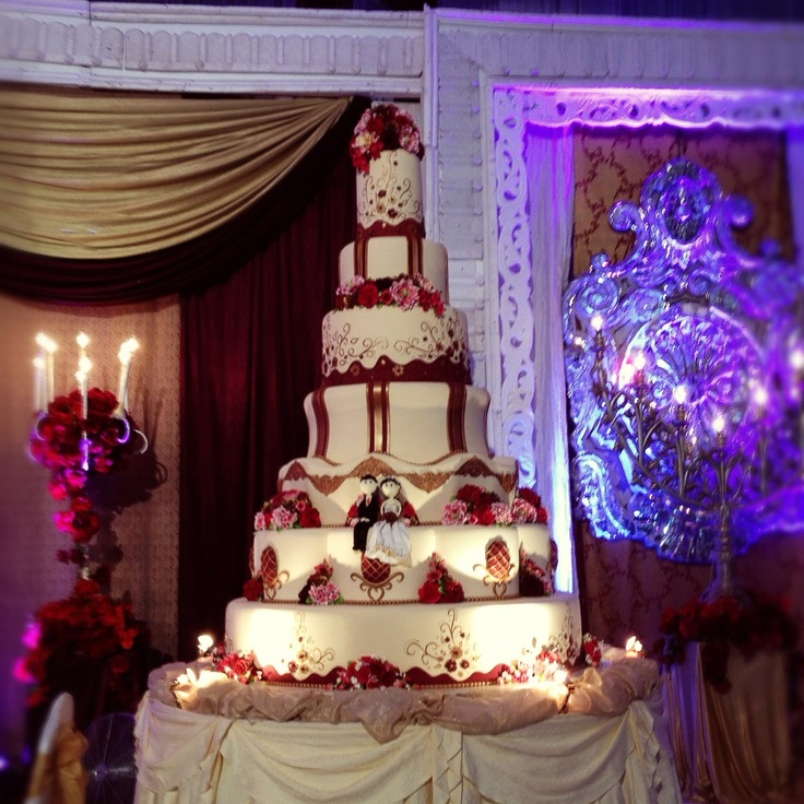 Burgundy gold wedding cake table