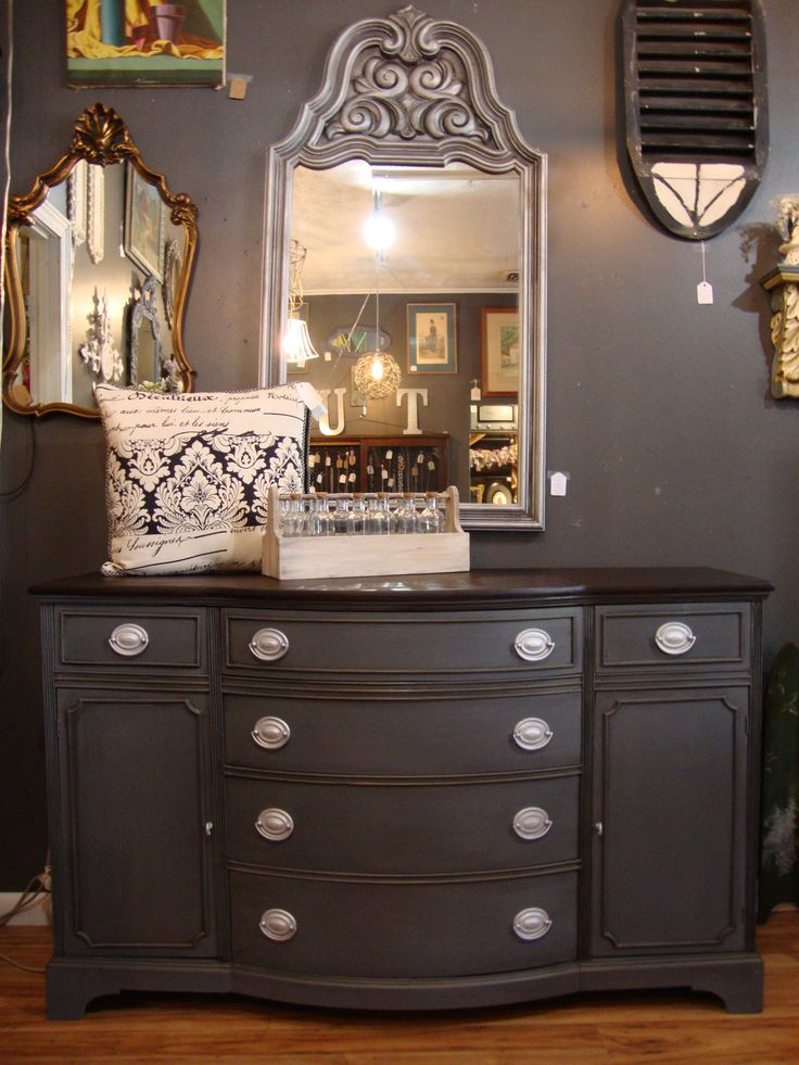 I love the classic elegance of a Duncan Phyfe Buffet. This one was painted in a custom mix of grays with the top stained in a dark brown. The original hardware was updated in a metallic silver.