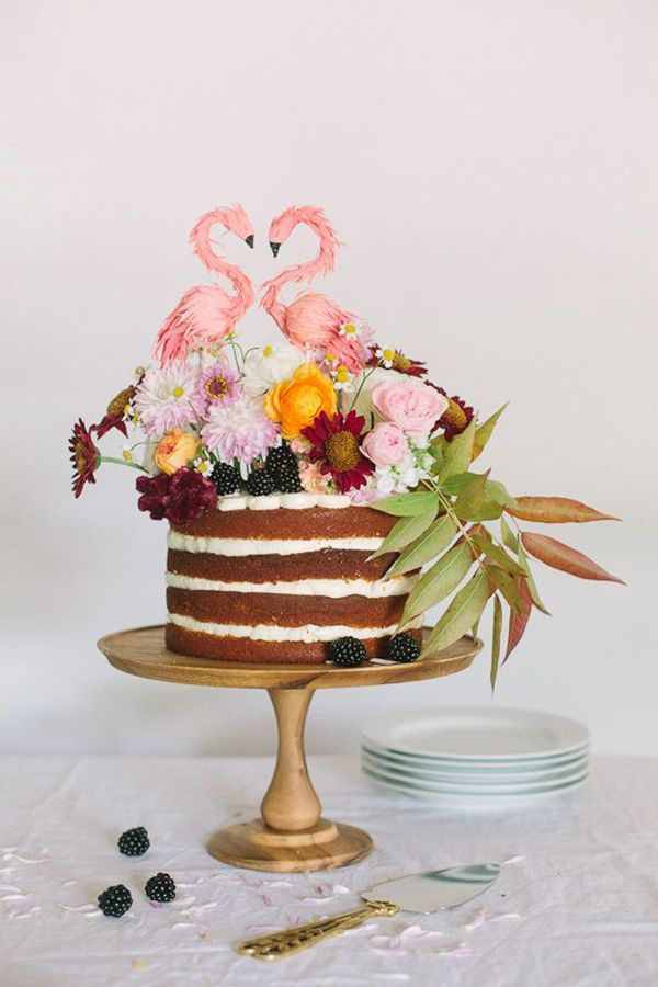 Artist Ann Wood captures the essence of the flamingo's delicate love dance in her tropically inspired topper, carefully crafted out of hand-painted crêpe paper. | Cake by Cakewalk Bake Shop | Photo by Apryl Ann