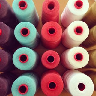 #roll upon roll of #threads just arrived for all my #new #summer #coloured #custom #bridesmaid #dresses = #happysewing