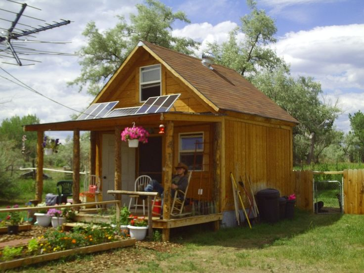 """This is my little solar cabin in the woods. It is 14x14 with a full loft upstairs and about 400 square feet. It cost under $2000 to build and is powered by a 570 watt solar and wind power system."" Site link offers plans to build your own solar cabin."