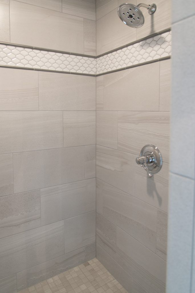Gray Tiled Shower With Square Tile Shower Floor And White Accent