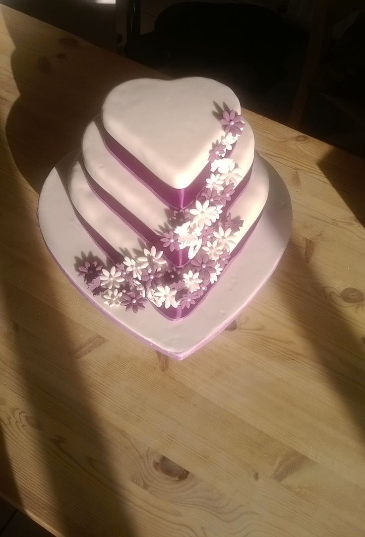 Purple / ivory heart shaped wedding cake. Bottom Tier - fruit cake Middle Tier - Vanilla sponge with raspberry jam and vanilla butter-cream filling  Top Tier - Chocolate sponge with vanilla butter-cream filling