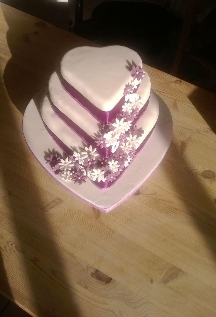 Purple / ivory heart shaped wedding cake. Bottom Tier - fruit cake Middle Tier - Vanilla sponge with raspberry jam and vanilla butter-cream filling  Top Tier - Chocolate sponge with vanilla butter-cream filling