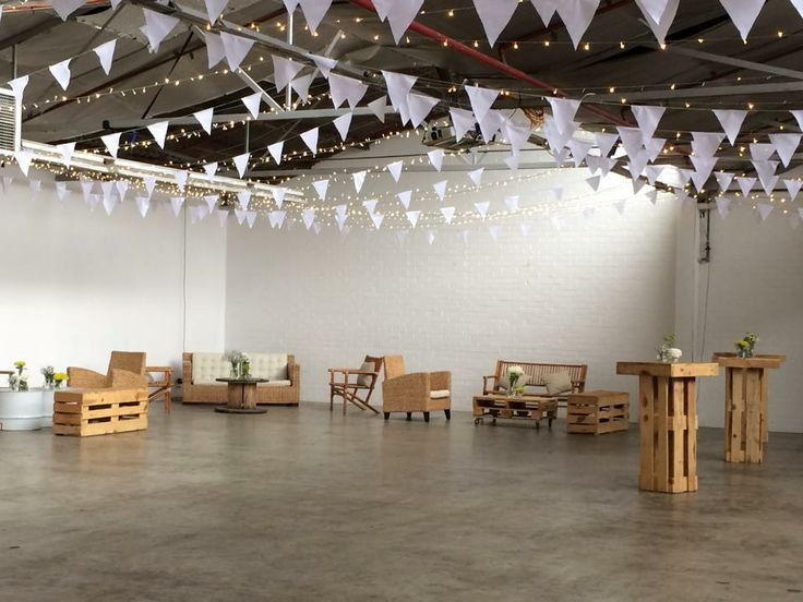 Autumn engagement featuring pallet furniture, white hand made bunting, fairy lights
