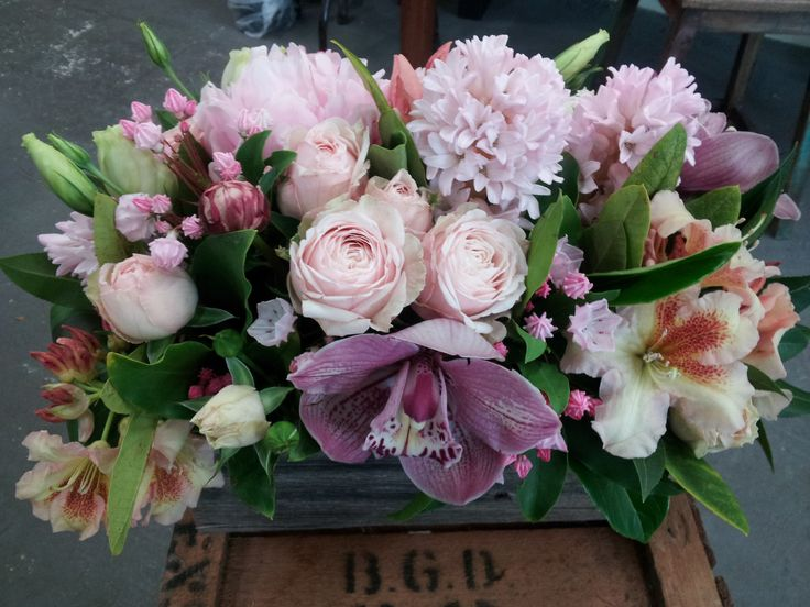 Rustic wooden box table centres using my favourite winter blooms, cymbidium orchids, hyacinths, clustar roses and azalea.