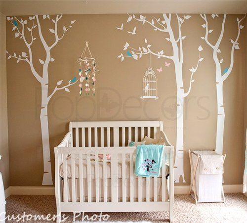 Large tree blowing in the wind with two little hedgehog's wall decal…