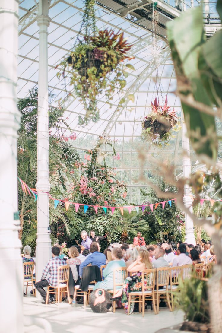 Image by Wookie Photography. - An Exotic Indian and English Fusion Wedding At Sefton Park Palm House In Liverpool With A Beautiful Vintage Lagonda And A Pink Handpicked Bouquet By Wookie Photography.