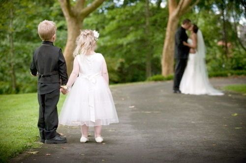 flower girl and ring bearer I would also have one standin beside them sayin ur next