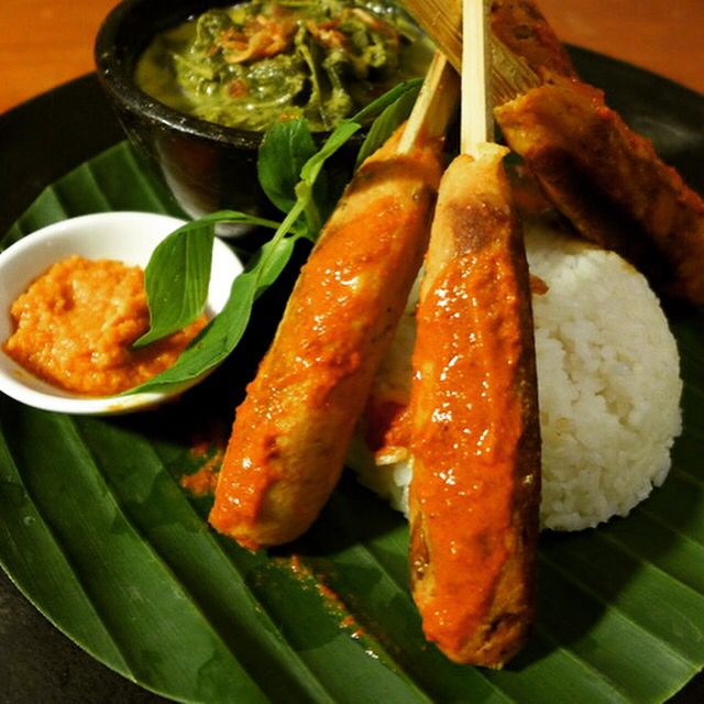 Sate Pusut - Minced tuna and coconut satay with cassava leaves cooked in coconut milk and local spices