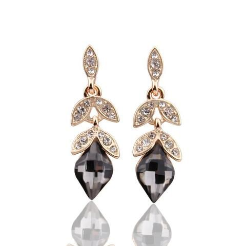 Gold and rose gold plated drop earrings have crystal deco