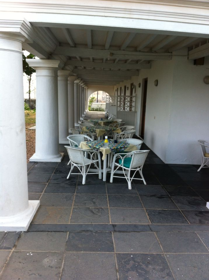 The outside seating area of meals at The Bungalow on the beach