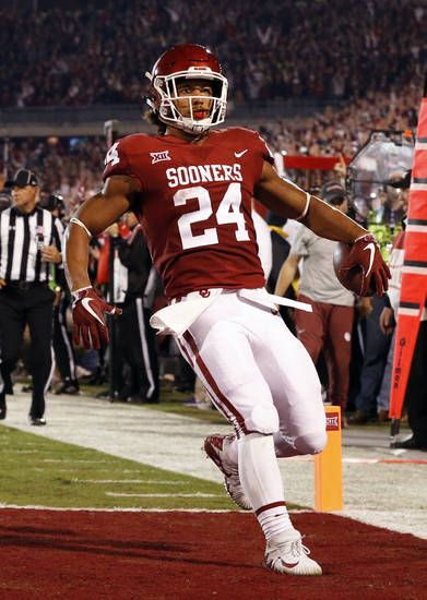 Oklahoma's Rodney Anderson (24) scores during a college football game between the University of Oklahoma Sooners (OU) and the TCU Horned Frogs at Gaylord Family-Oklahoma Memorial Stadium in Norman, Okla., on Saturday, Nov. 11, 2017. Photo by Steve Sisney, The Oklahoman