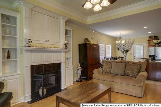 Baton Rouge Apartments  : Choose Your Location: Ecletic Baton Rouge Apartments With Great Interior Design Ideas For Living Room Using Modern Sofas With Decorative Pillow Also Fireplaces And Custom Cabinet Laminate Wood Flooring As Well Ceiling Fans With Lights ~ surrealcoding.com Apartments Inspiration