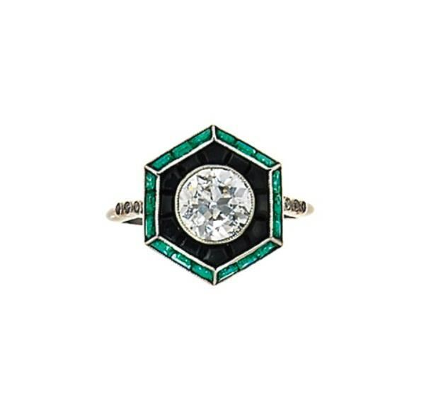 An Art Deco Diamond, Emerald and Onyx Ring. Photo: Christie's Images Ltd 2012 OMG adore!