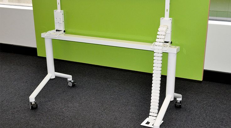Flip Table with Cable Snake Cube in white. See more at http://elsafe.com.au/en/case-study-cable-snake