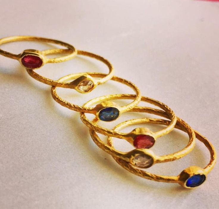 18 carat gold rings with diamonds, rubies and blue sapphires