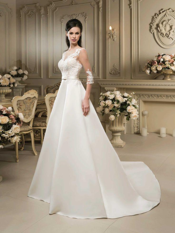 Krásne svadobné šaty so saténovou sukňou s dlhou vlečkou a čipkovaným vrškom