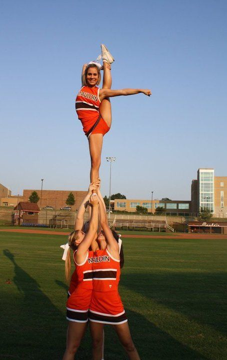I am the spotter on the left. I am Addison trying out for back spot and JV co captain. 1