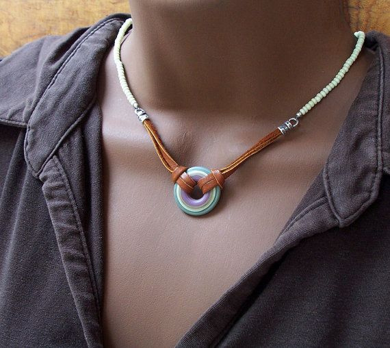 necklace : like the colored disk with the leather and seed beads