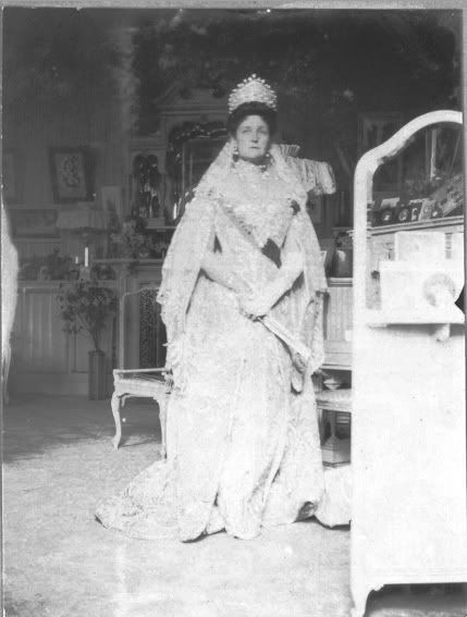 Empress Alexandra in her famous mauve boudoir at the Alexander Palace at Tsarskoe Selo - dressed in official court dress