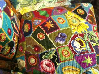 This is a Kaffe Fassett designed chair cover - what a good idea for incorporating a lot of separate motifs in a modern take on the traditional embroidered seat cover.