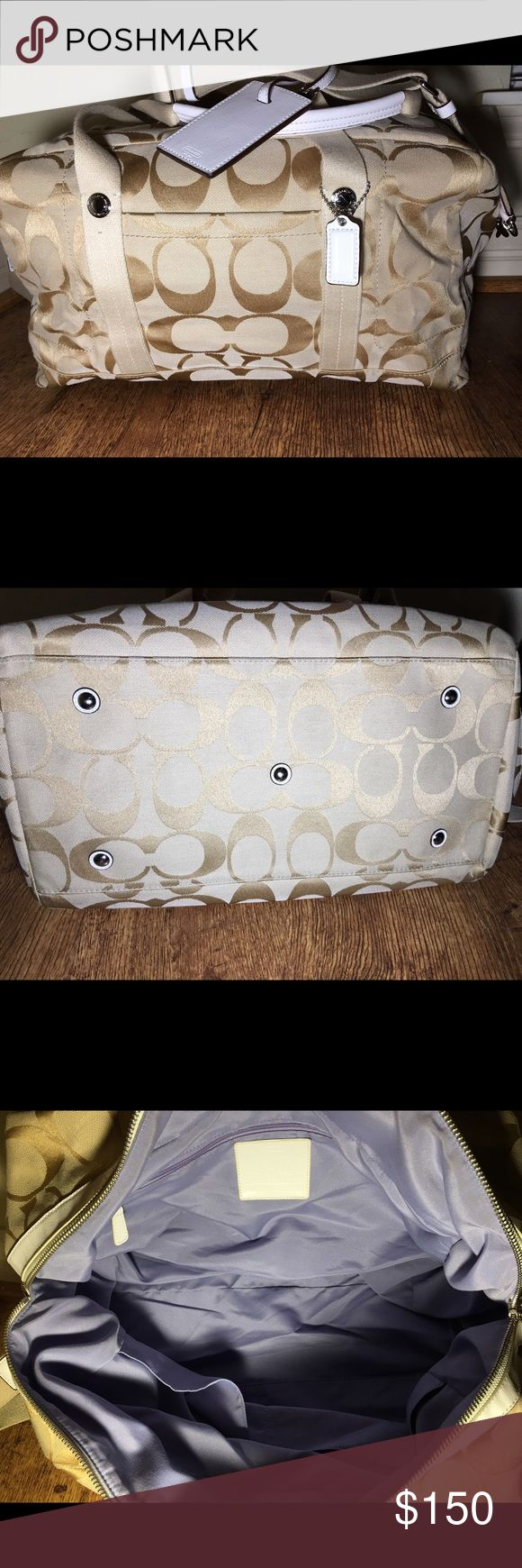 Coach Duffle Bag Beautiful and Spacious Coach Duffle Bag. Used a few times for business travel trips. No damage or wear and tear. Like new! Coach Bags Travel Bags
