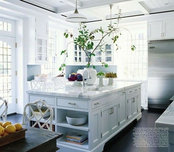 This kitchen is gorgeous. Love all the white!