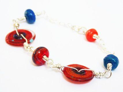 Orbit Bracelet! #casualjewelry #lampworkbracelet #sterlingsilver #redandblue #funbracelet #boldbracelet