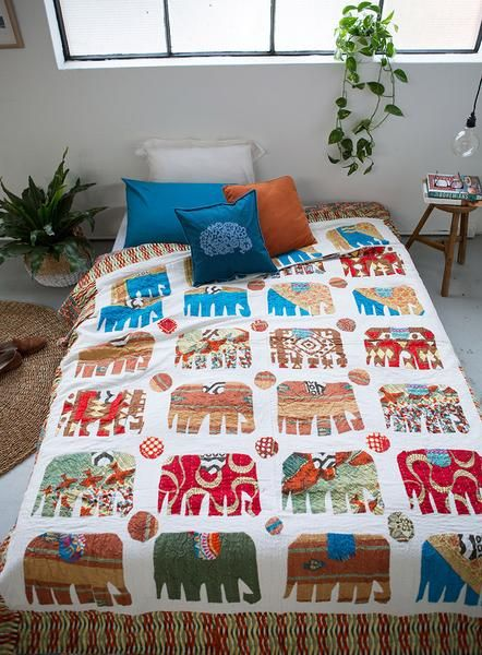 Hand appliquéd elephant quilts each one unique & one-off....Use code AUSDAY17 to get 25% off storewide
