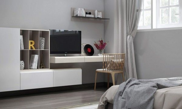 Modular wall hung units are perfect for connecting spaces on any scale, such as this set that wraps beneath a desk to blur the boundaries be...