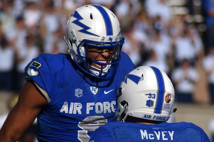 Air Force Academy Cadet 1st Class Jalen Robinette, wide receiver for the Falcons, reacts to a touchdown by Cadet 2nd Class Tim McVey, a running back, during the Air Force vs. Navy game at the academy's Falcon Stadium in Colorado, Oct. 1, 2016. The Falcons defeated the Midshipmen 28 to 14. Air Force photo by Airman 1st Class Dennis Hoffman