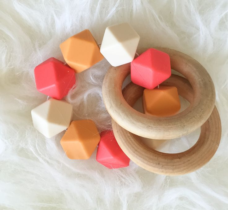 Made with food-grade, BPA-free silicone beads and all natural wooden rings. This teether is perfect for keeping any teething baby happy. It's easy to hold onto and it doubles as a rattle.