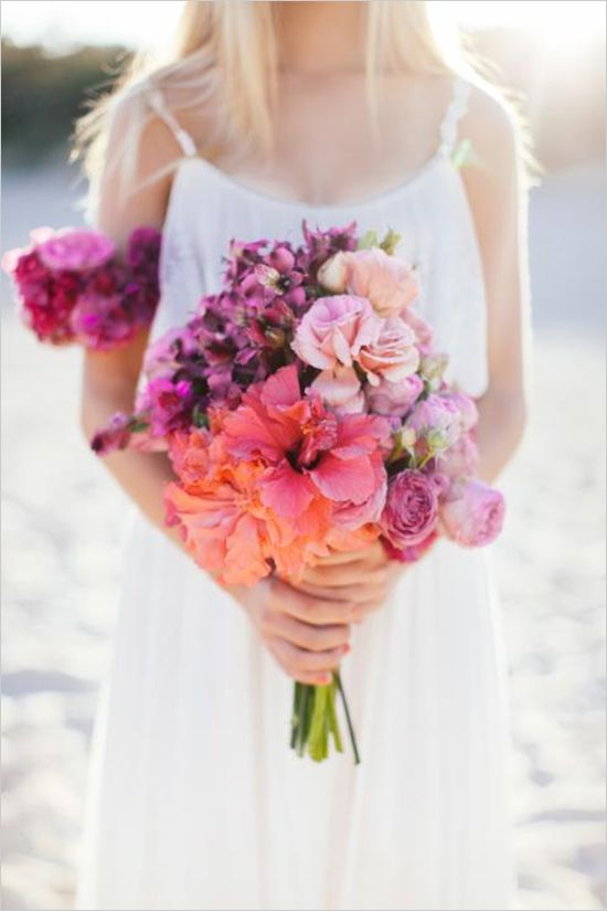 Easy beach wedding ideas and rainbow hibiscus bouquet! #weddingchicks Captured By: Brooke Adams Photography http://www.weddingchicks.com/2014/07/04/free-seahorse-monogram/