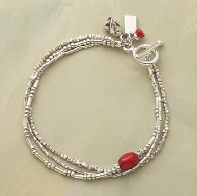"""silver three ways bracelet Three strands of Thai silver beads are set off with coral embellishments and a rosebud charm. Sterling silver toggle clasp. Handmade in USA. 7-1/2""""L."""