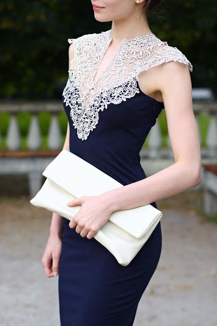 Navy sheath with gorgeous lace detailing at the neck - so regal!.