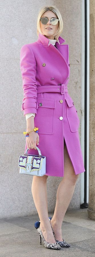Milan Fashion Week street style: pink belted military coat with reflective sunglasses, bold patterned heels and a colorful mini purse.