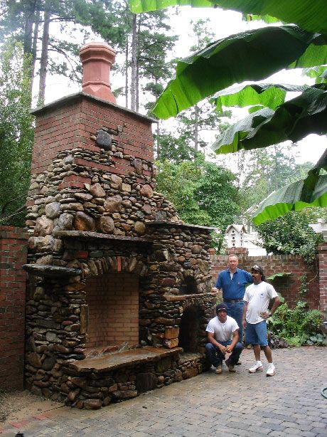 Like the use of stones/rocks (not so much the chimney) and it looks like a pizza oven too.