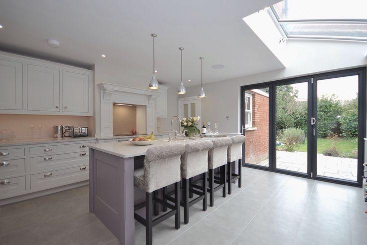 Davonport shaker kitchen with polished nickel Hafele cup handles, large format grey floor tiles, grey bi-fold door and glazed roof section.