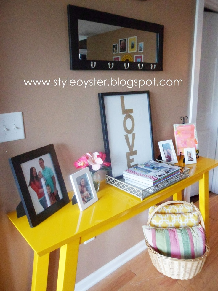 Style oyster yellow console table and love painting no for Sofa table yellow