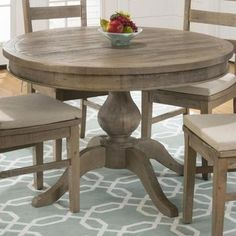 The cottage style look of this table is the shabby-chic style you have been looking for. Made from reclaimed pine with a light slater mill pine finish, this table has an antique cottage look that is any households dream. With a leaf to turn this round table into an oval table and seat more of...