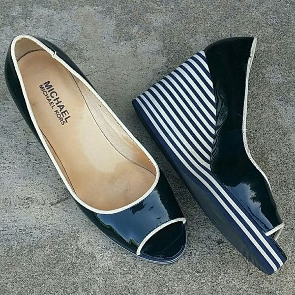 Bundled!! MICHAEL KORS Striped Navy Wedge heels Patent leather and cute nautical stripes!  Navy and white Size 6 TTS Preowned but very lightly worn! Excellent condition!  Bundle any 2 items from my closet and get 20% off automatically Michael Kors Shoes Wedges