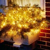 Window Box Chic Fill a window box with greenery studded with lights to glitter in the icy air all season long.