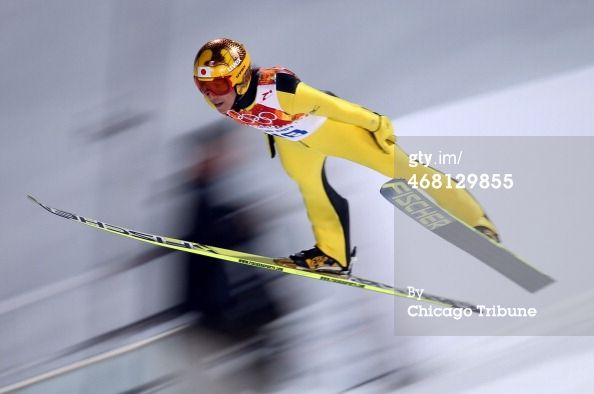 Noriaki Kasai, of Japan, flies in a trial run of the men's normal hill competition at the RusSki Gorki Jumping Center during the Winter Olym...