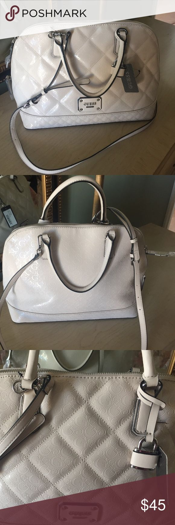 Guess satchel Handbag Brand new with tags satchel Handbag cream color beautiful. This is authentic bag great quality. Check online to see how much this bag sells for Guess Bags Satchels