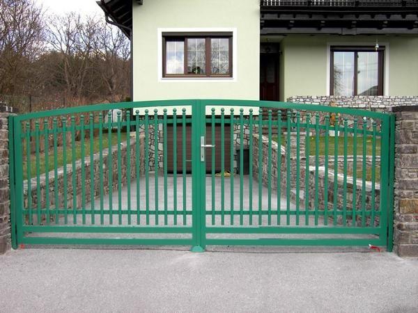 green coated metal driveway gate