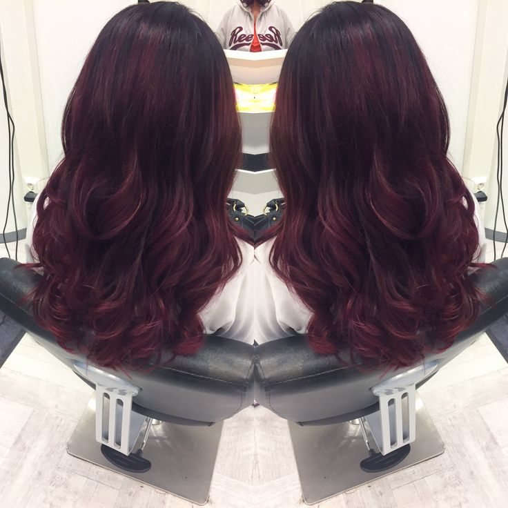 Pinky burgundy hair color with balayage and hollywood curls.